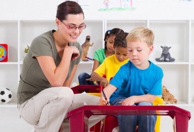teacher attending her pupils